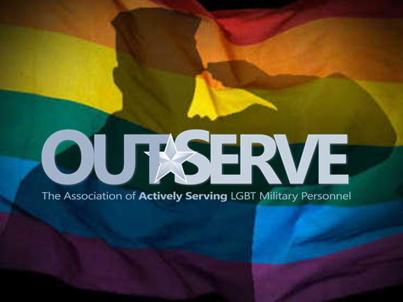 silhouette of solider saluting rainbow flag